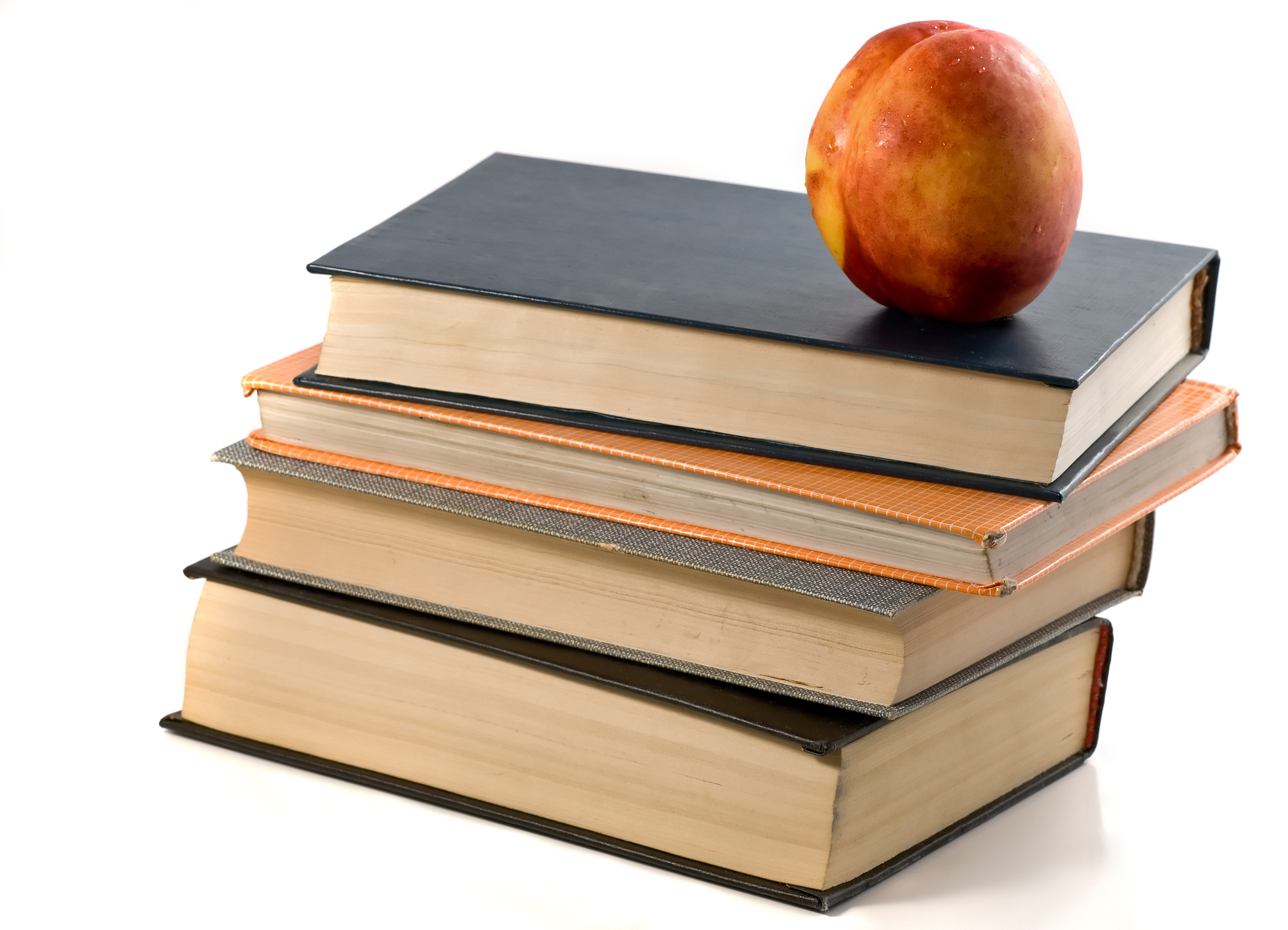 books and nectarine isolated white